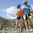 Stockfoto: Young Couple On Bicycles In Mountains