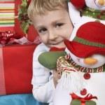 Elementary Boy Holding Stuffed Snowman — Stock Photo #21792129