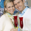 Royalty-Free Stock Photo: Couple Holding Flutes Of Champagne