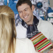 Royalty-Free Stock Photo: Male Receiving Christmas Gift From Woman