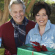 Multiethnic Couple With Gift Boxes Outdoors - Stock Photo