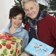 Multiethnic Couple Holding Gifts — Stock Photo