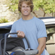 Young Man Carrying Cradle Standing By Car — Foto Stock