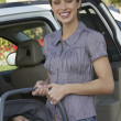 Woman With Baby In Carrier — Stock Photo
