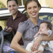 Mother With Baby By Car - Stock Photo