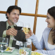 Young Couple Toasting Wineglasses — Stock Photo