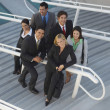 Multiethnic Businesspeople On Stairs — Stock Photo