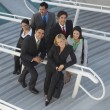 Multiethnic Businesspeople On Stairs — Stock Photo #21796807