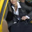 Businesswoman Getting Out Of Taxi — Stock Photo