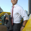 Businessman Getting Out Of Taxi — Stock Photo