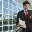 Businessman Using Mobile Phone Outside Office — Stock Photo