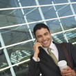 Foto Stock: Businessman Using Mobile Phone