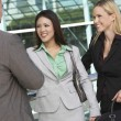 Businesspeople Smiling Outside Office — Stock Photo #21797229
