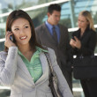 Businesswoman Using Cell Phone Outside Office — Stock Photo #21797249