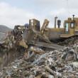 Stock Photo: Digger Moving Waste