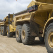 Stock Photo: Excavators Parked In Row