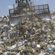 Moving Trash In A Landfill — Stock Photo #21797613