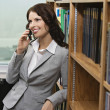 Businesswoman Using Cell Phone In Library — Stock Photo