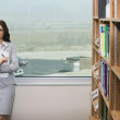 Thoughtful Female In Library — Stock Photo