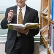 Smiling Senior Business Man In Library — Stock Photo