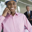 Architect On A Call With Blueprint — Stock Photo