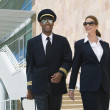 Pilot And Flight Attendant Outside Building — Stock Photo #21798221