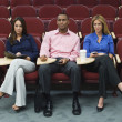 Stock Photo: Business Sitting In Auditorium