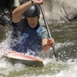 Young man whitewater kayaking - Stock Photo