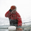 Stock Photo: Fisherman With Fishing Net On boat
