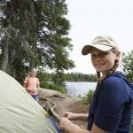 Teenage Girls Standing By Tent Near Lake — Stock Photo