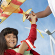 Girl Holding Airplane Kite At Wind Farm — 图库照片