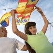 Girl Holding Airplane Kite With Father — Стоковая фотография