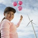 Girl Holding Balloons At Wind Farm — Stock Photo