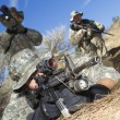 Soldiers Aiming Machine Guns - Stock Photo