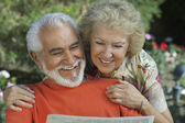 Couple Reading Newspaper Together — Stock Photo