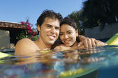 Happy Couple In Swimming Pool — Stock Photo