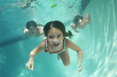 Portrait of a preadolescent children swimming underwater — Stok fotoğraf