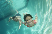 Father And Daughter Swimming Underwater — Stock Photo