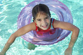 Girl Floating On Inflatable Raft In swimming Pool — Stock Photo