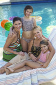 Happy Family Together At Poolside — Stockfoto