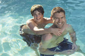 Father And Son Enjoying In Pool — Stock Photo
