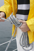 Midsection Of Man Tying Rope On Sailboat — Stock Photo