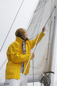 Man Holding Rigging On Sailboat — Stock Photo
