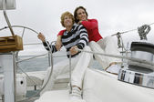 Couple Sitting On Yacht By Helm — Stock Photo