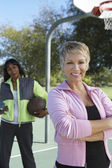 Woman With Friend At Basketball Court — Stock Photo