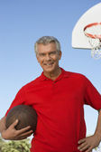 Man Holding Basketball At Court — Stock Photo