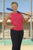 Woman Holding Baseball Bat — Stockfoto