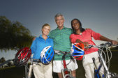 Multiethnic Friends Standing With Bicycles — Stock Photo