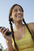 Young Woman Listening To Mp3 Player — Stock Photo