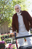 Senior Man With Walking Frame At Botanical Garden — Stock Photo